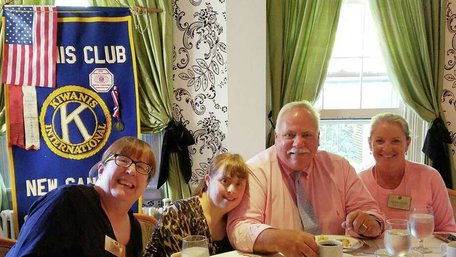 Kiwanis President BJ Flagg, from left, Nicki DuBiago, a STAR participant who is a New Canaan resident, Peter Saverine, director of philanthropy at STAR, Tucker Murphy, executive director of the New Canaan Chamber of Commerce, attend a recent Kiwanis luncheon. Photo: Contributed Photo / New Canaan News