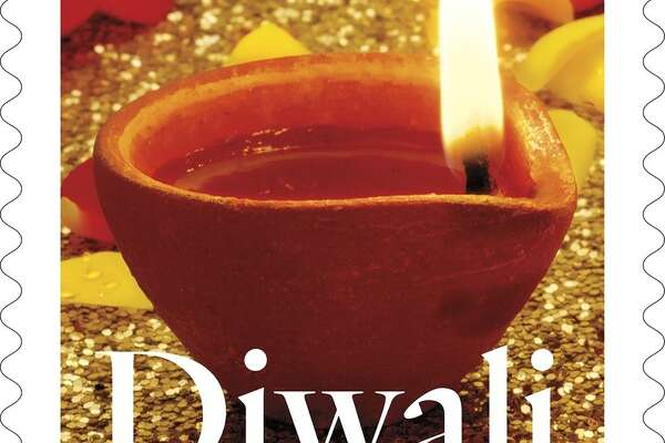 A Diwali stamp featuring a photograph by Sally Andersen-Bruce.
