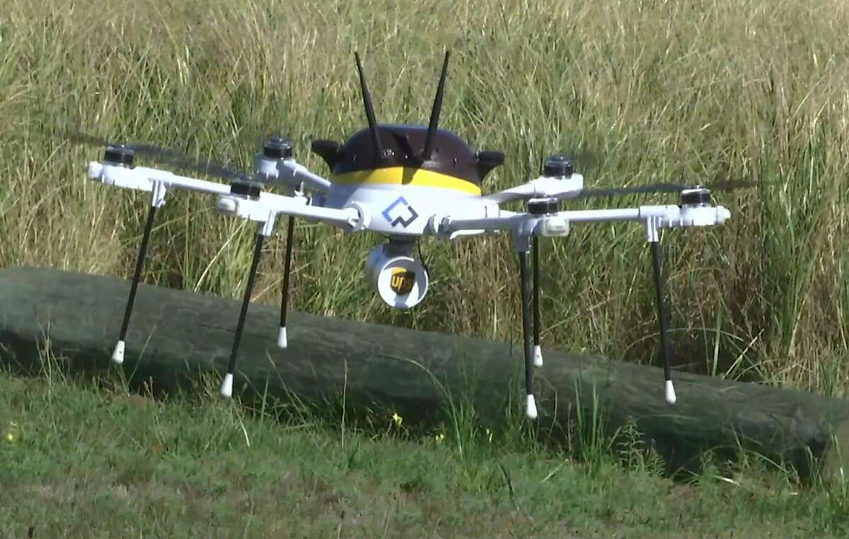 In this Thursday, Sept. 22, 2016 still image from video, a test drone making a UPS delivery lands on Children's Island in Marblehead, Mass. UPS partnered with robot-maker CyPhy Works to fly the drone on a programmed route for three miles over the Atlantic Ocean to make the delivery. (AP Photo/Rodrique Ngowi)