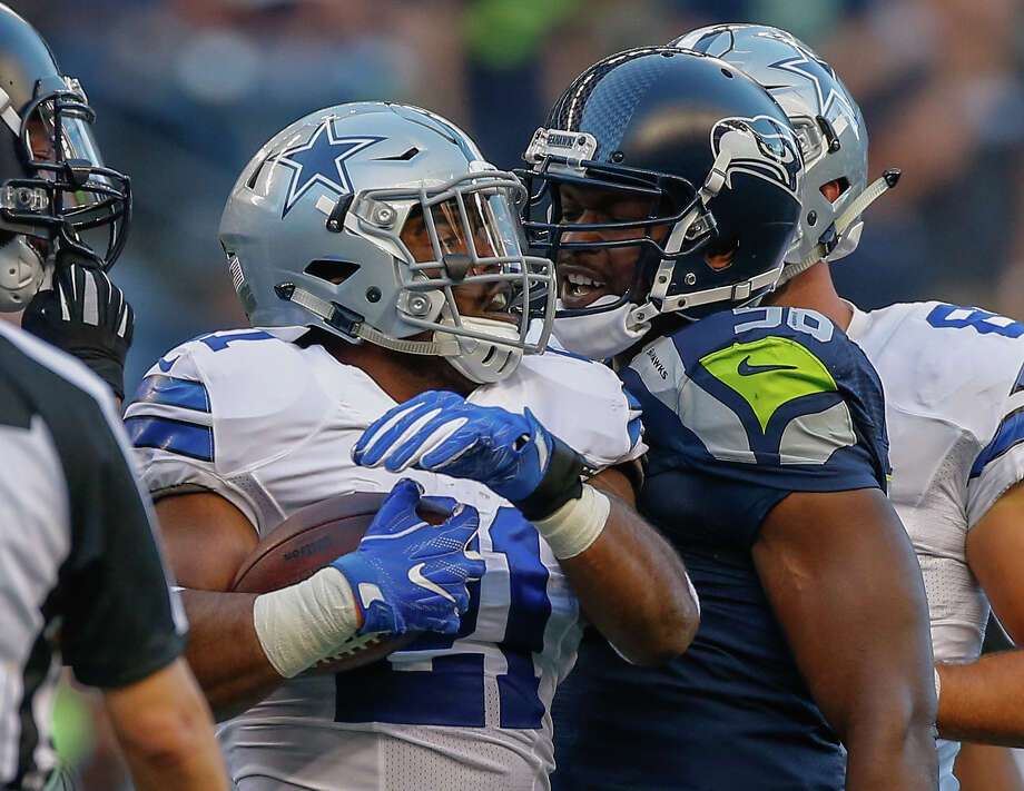 SEATTLE, WA - AUGUST 25:  Running back Ezekiel Elliott #21 of the Dallas Cowboys exchanges words with defensive end Cliff Avril #56 of the Seattle Seahawks after being stopped on a rushing play at CenturyLink Field on August 25, 2016 in Seattle, Washington. The Seahawks defeated the Cowboys 27-17.  (Photo by Otto Greule Jr/Getty Images) Photo: Otto Greule Jr/Getty Images