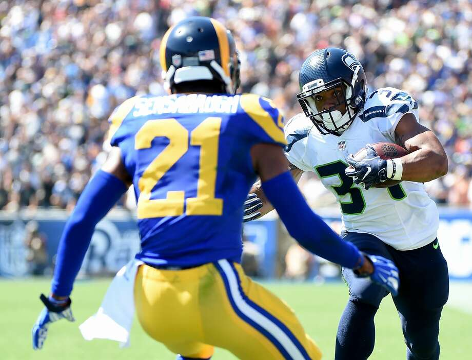 Thomas Rawls of the Seattle Seahawks runs after his catch as Cody Sensabaugh of the Los Angeles Rams defends during the first quarter of the home opening NFL game between the Los Angeles Rams and the Seattle Seahawks at Los Angeles Coliseum on September 18, 2016 in Los Angeles, California.  (Photo by Harry How/Getty Images) Photo: Harry How/Getty Images