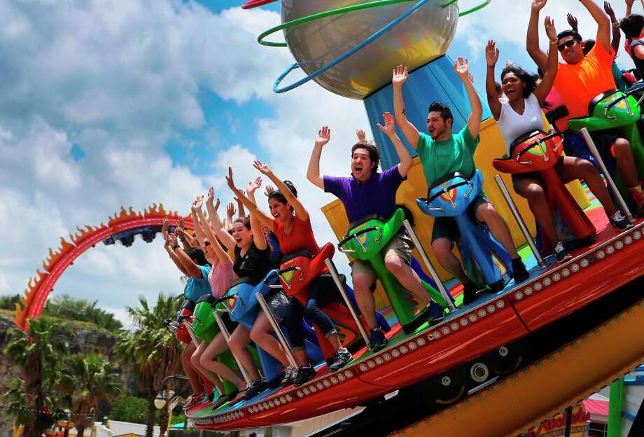 Riders check out the new Hurricane Force 5 ride in the Fiesta Bay Boardwalk area of Six Flags Fiesta Texas. Another new ride, Fireball, is in the background. Photo: Courtesy Photo / ©San Antonio Express-News/John Davenport