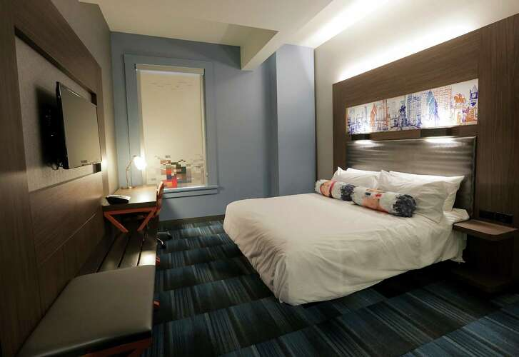 A king-size bed is in a room at the Aloft Houston Downtown. The hotel will have systems like keyless doors that can be opened with a swipe of a smartphone.