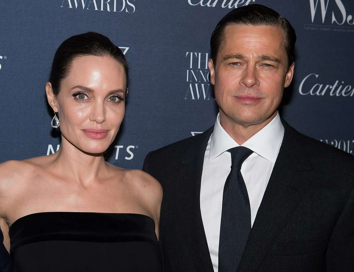 FILE - In this Nov. 4, 2015 file photo Angelina Jolie Pitt and Brad Pitt attend the WSJ Magazine Innovator Awards 2015 at The Museum of Modern Art in New York. Jolie has filed for divorce from Pitt, bringing an end to one of the world's most star-studded, tabloid-generating romances. (Photo by Charles Sykes/Invision/AP, File)