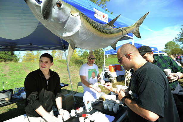 The 9th annual Chowdafest takes place Sunday, Oct. 2, at Sherwood Island State Park in Westport. Seen here at last year's festival are, from left; David and Rich Herzfeld of The Chef's Table restaurant in Fairfield, serving their Rhode Island clam chowder to Jay Santi, of Stratford.
