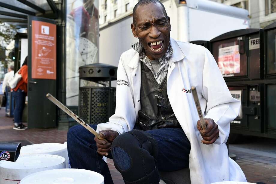 "Larry ""Bucket Man"" Hunt has been drumming on plastic buckets for 22 years, entertaining tourists at the cable car turnaround at Powell and Market streets. Photo: Michael Short, Bloomberg"