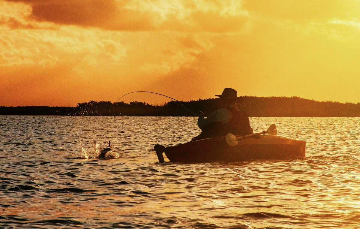 Kayaking anglers can find plenty of peace, quiet and fish on Texas bays on cool, calm autumn days.