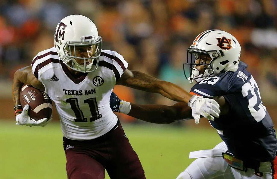 Wide receiver Josh Reynolds of the Texas A&M Aggies tries to get around defensive back Johnathan Ford of the Auburn Tigers as he carries the ball during the second half on Sept. 17, 2016. Texas A&M Aggies won 29-16. Photo: Butch Dill /Getty Images / 2016 Getty Images
