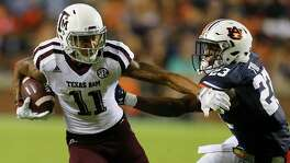 Wide receiver Josh Reynolds of the Texas A&M Aggies tries to get around defensive back Johnathan Ford of the Auburn Tigers as he carries the ball during the second half on Sept. 17, 2016. Texas A&M Aggies won 29-16.
