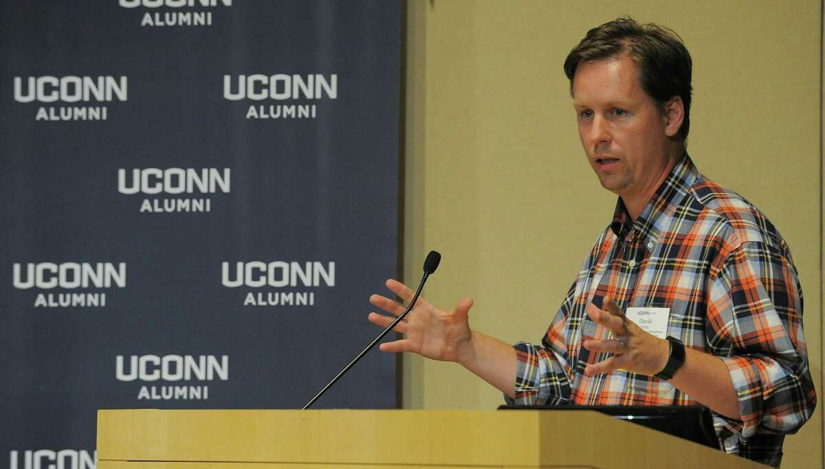 David Noble, a professor in UConn's business school, holds a panel discussion on entrepreneurship in the GenRe auditorium at its Stamford UConn campus.