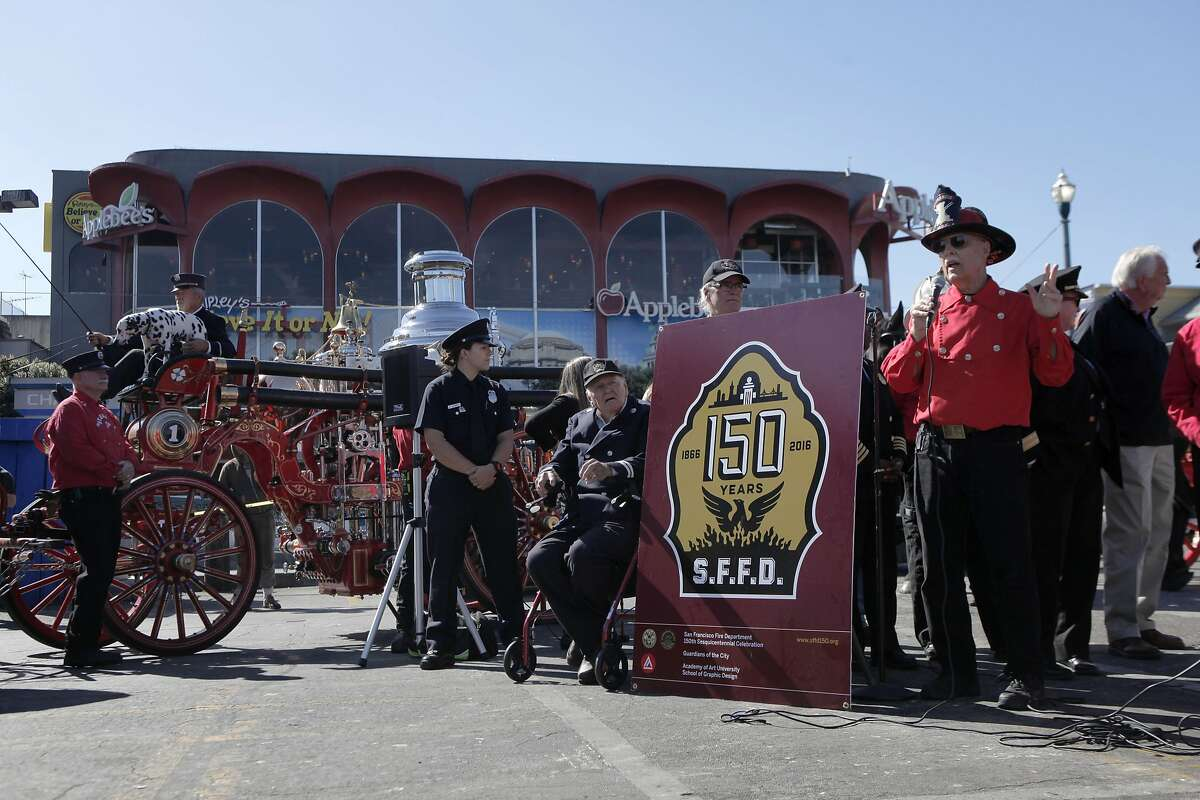 Youngest San Francisco Fire Department member Amanda Conroy (center left), 21, and oldest retired member Battalion Chief Al Waight (center right), 97, at the announcement of the San Francisco Fire Department's 150th anniversary parade at Fisherman's Wharf in San Francisco, Calif. on Friday, September 23, 2016.