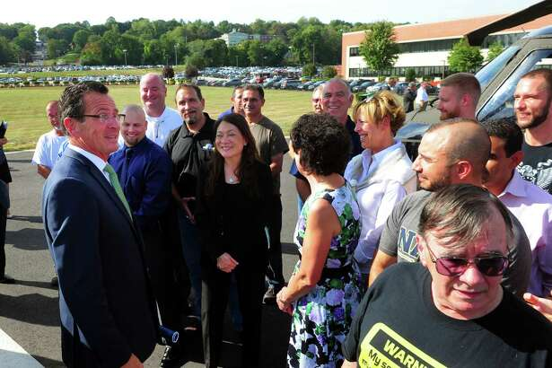 Governor Dannel P. Malloy greets workers after a news conference at Sikorsky Aircraft in Stratford.