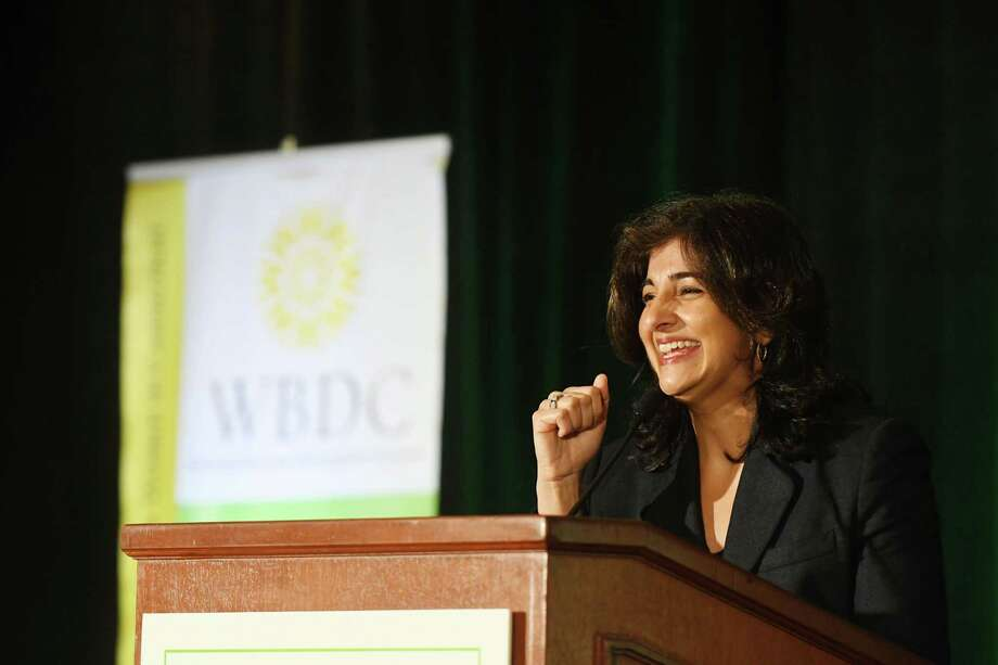 Norwalk's Seema Hingorani receives the WBDC Woman with Impact award at the Women's Business Development Council's annual Women with Impact Business Breakfast and Symposium at the Hyatt Regency Greenwich in Greenwich, Conn., Sept. 23, 2016. Hingorani, founder of Girls Who Invest, received the award for her work in closing the gender gap and paving the way for women in the business world. Photo: Keelin Daly / For Hearst Connecticut Media / Norwalk Hour freelance