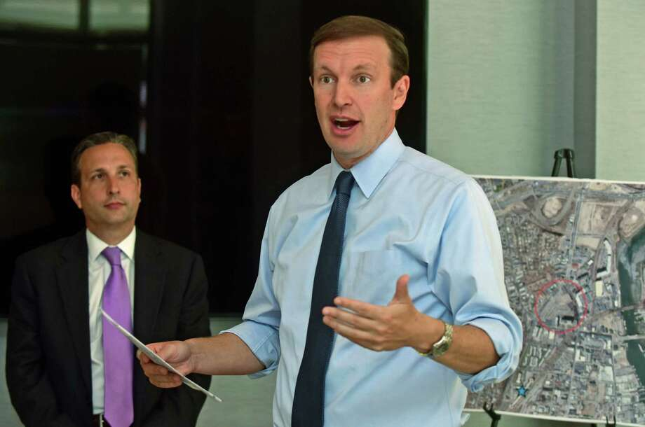 U.S. Senator Chris Murphy (D-Conn.) hosts an event with elected official and local developers at the SoNo Pearl Friday, September, 23, 2016, to discuss Transit-Oriented Development Projects near the South Norwalk Train Station in Norwalk, Conn. Murphy joined State Senator Bob Duff for an update on the city's economic development projects along Washington Street including the new SONO Pearl apartment complex. Economic development projects in South Norwalk have received millions in federal investments, including transit-oriented development funding, HUD Choice Neighborhoods funding, and Community Development Block Grant funding. Photo: Erik Trautmann / Hearst Connecticut Media / Norwalk Hour