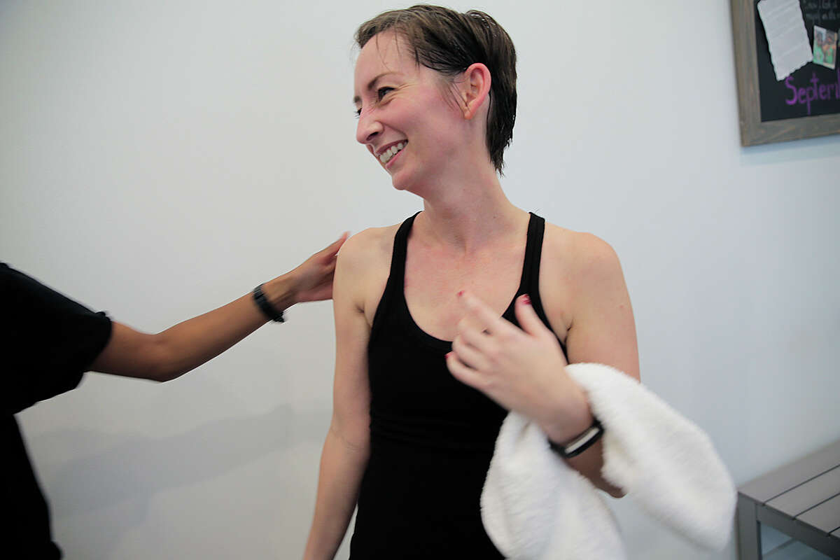 Cancer survivor Lauren Brigance is photographed between classes at Revolution Studio. Brigance used cycling to as a way to deal with ovarian cancer. Wednesday, Sept. 14, 2016, in Houston. ( Elizabeth Conley / Houston Chronicle )