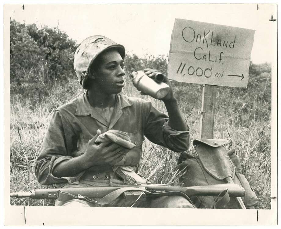 June 4, 1966. Pfc. Clairborne L. Shaw of Oakland, pausing for a drink in 120-degree heat. Photo: Collection Of The Oakland Museum Of California.
