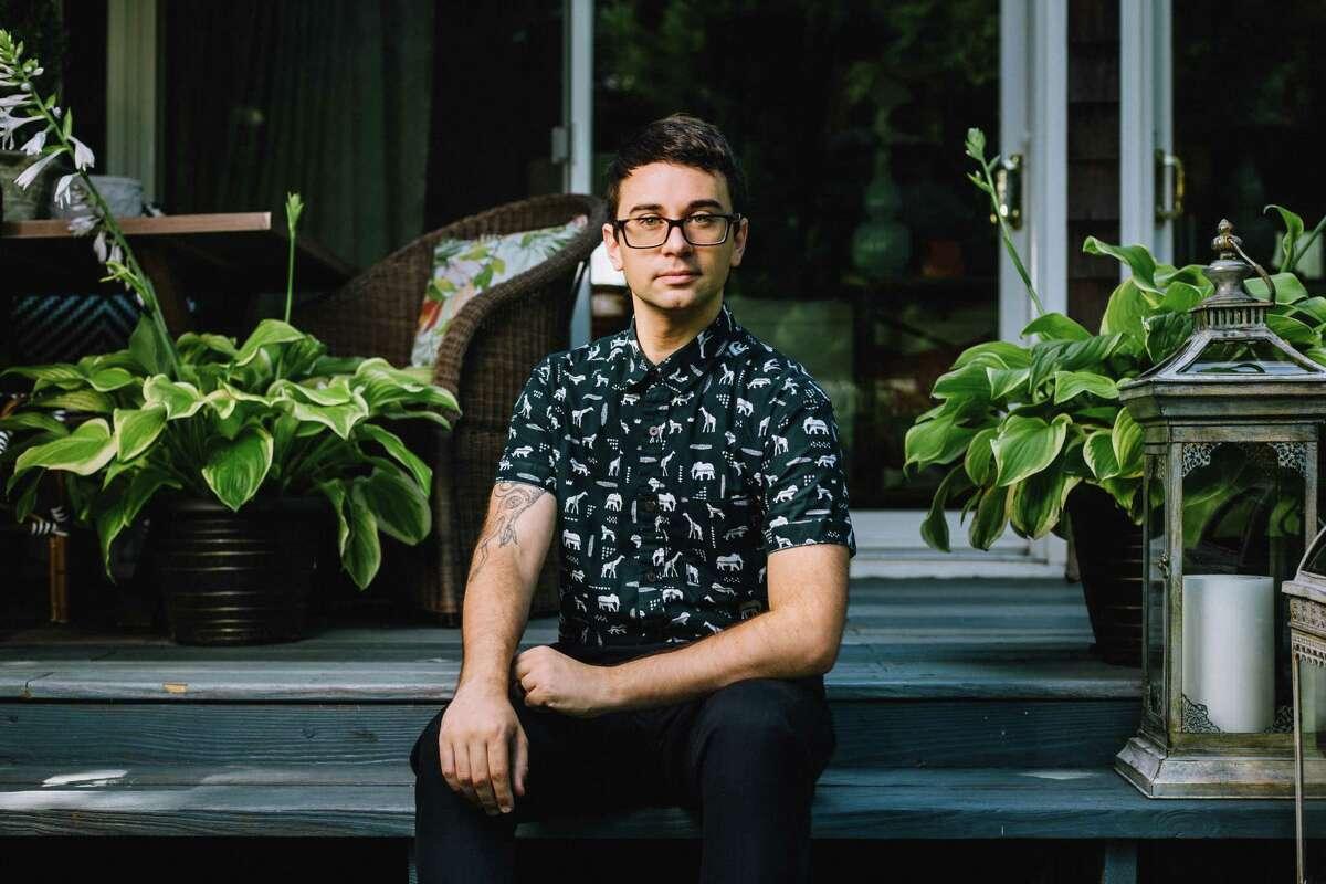 Fashion designer Christian Siriano sitting on his back porch at his Danbury home.