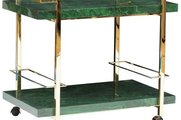 Maddox bar cart: You'll want to host cocktail night every night of the week with this sleek, modern bar cart, made of rich green malachite and gleaming brass. Its lower shelf will hold 14 wine bottles, but there's plenty of room for barware. Available at High Fashion Home; $1,099.