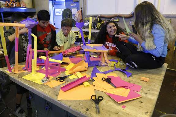 Students construct paper roller coasters for marbles in a hands-on technology class taught by Stephan Willner at Sequoia Middle School in Pleasant Hill, Calif. on Wednesday, Sept. 21, 2016. Passage of Prop. 55 on the November ballot would benefit schools by extending tax increases on individuals with incomes over $250,000 for an additional 12 years.