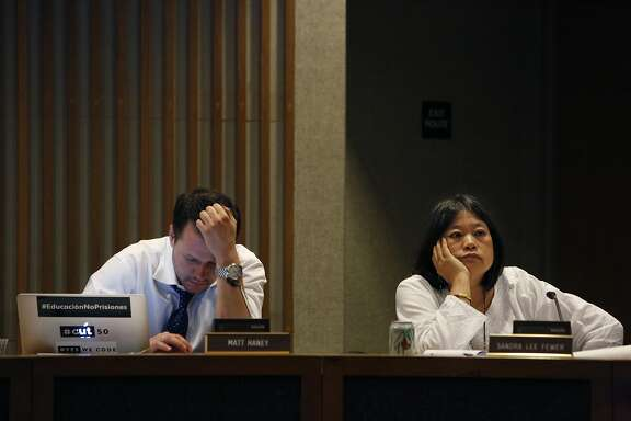 Matt Haney (l to r), Board of Education vice-president and Sandra Lee Fewer, Board of Education commissioner, listen to speakers as they work during a meeting of  the Board of Education Augmented Ad Hoc  Committee on Student Assignment in the Irving G. Breyer Board Meeting Room on Monday, April 13, 2015 in San Francisco, Calif.