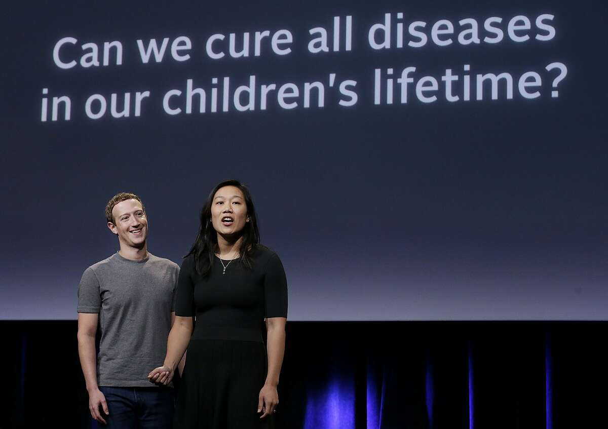 In this Tuesday, Sept. 20, 2016, photo, Facebook CEO Mark Zuckerberg, left, and his wife, Priscilla Chan, rehearse for a speech in San Francisco. Zuckerberg and Chan have a new lofty goal: to cure, manage or eradicate all disease by the end of this century. To this end, the Chan Zuckerberg Initiative, the couple's philanthropic organization, is committing significant financial resources over the next decade to help accelerate basic science research. (AP Photo/Jeff Chiu)