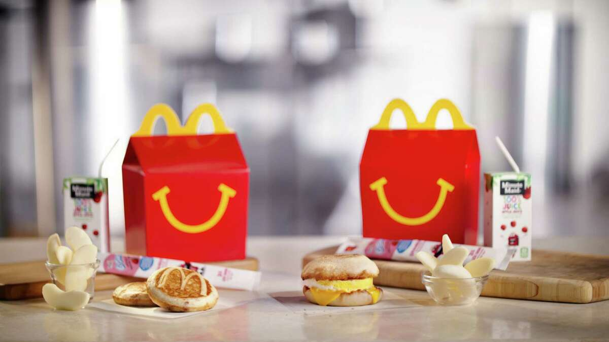 McDonald's is considering another addition to its all-day breakfast menu: Happy Meals. The fast-food chain says it will begin testing breakfast Happy Meals in Tulsa, Okla., on Sept. 26. The Happy Meals come with either two McGriddles cakes or an egg and cheese McMuffin.(McDonalds via AP)