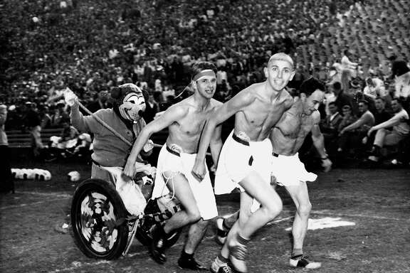Nov. 24, 1946 (Stanford 25, Cal 6): Shirtless Cal fans pull Oski in a chariot at a Big Game in 1946. The saddle shoes add to the degree of difficulty.