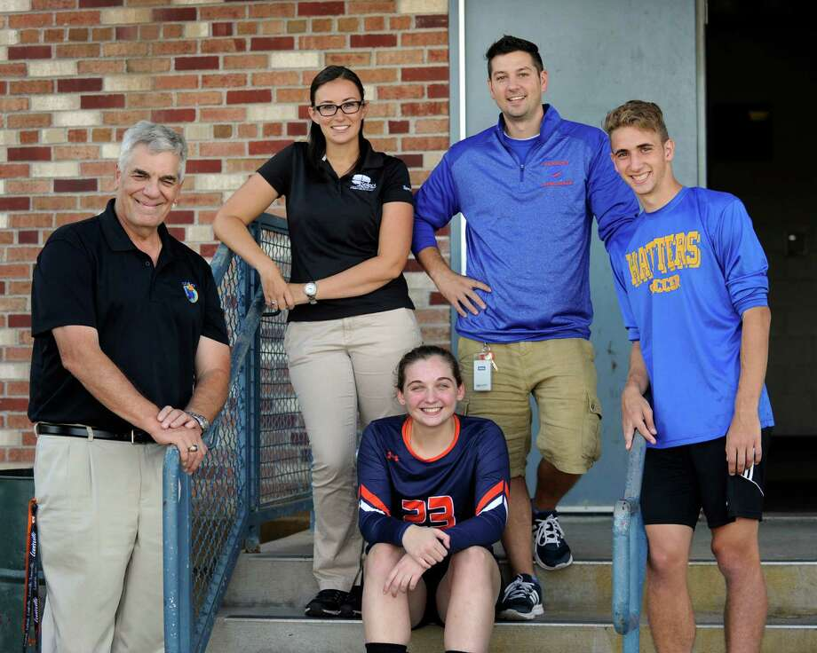 From left, Chip Salvestrini, Danbury High School athetic director, Emily Renna, athletic trainer, Emily Broggy, 17, a senior and captain of the volleyball team, James Ascone, a teacher and coach, and Kevin Spennato, 17, a senior and captain of the boys varsity soccer team, are spearheading efforts to raise awareness about domestic violence and sexual abuse.  Photo Friday, Sept. 23, 2016. Photo: Carol Kaliff / Hearst Connecticut Media / The News-Times