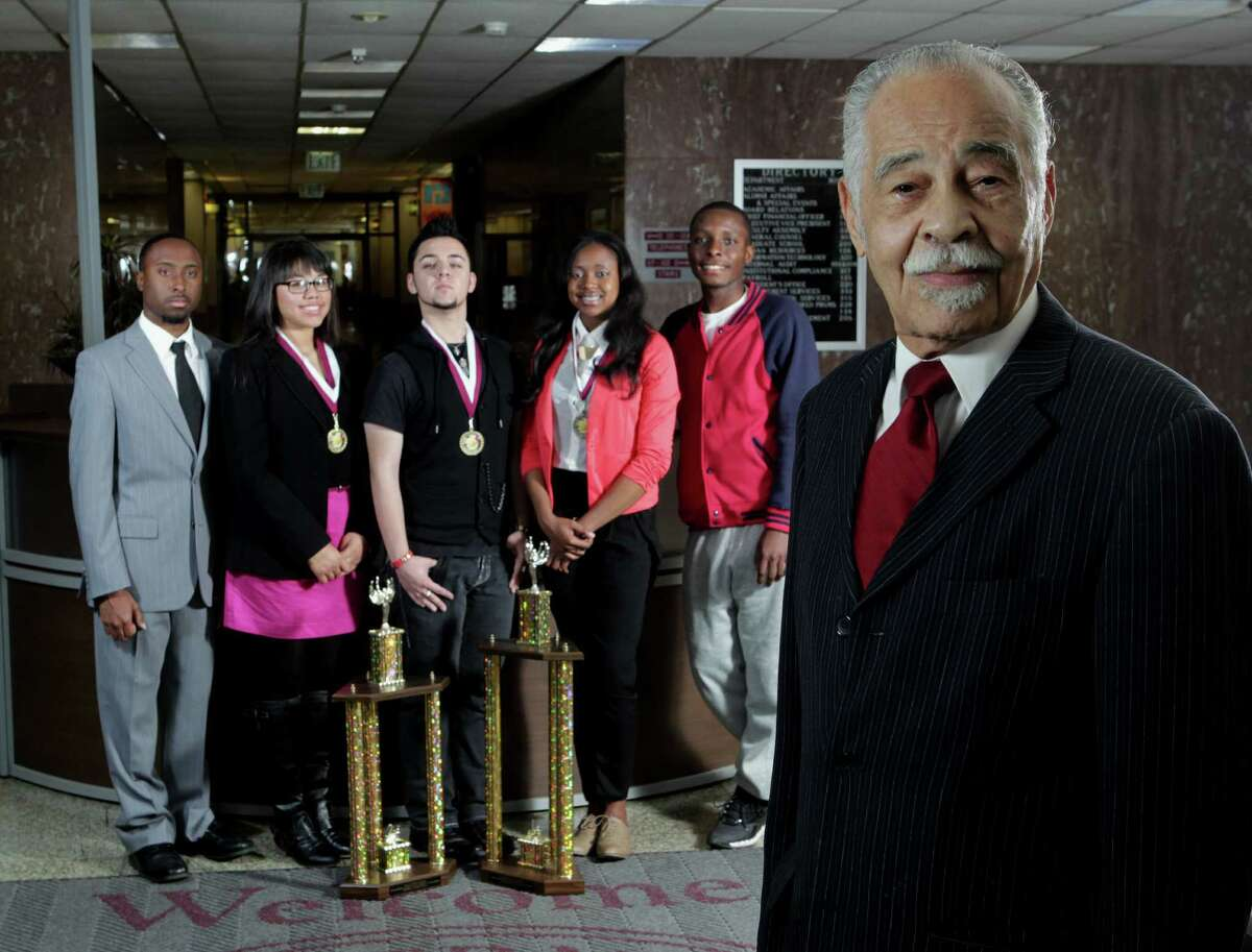Texas Southern University Debate Team founder and debate team coach Dr. Thomas F. Freeman right, poses for a portrait with debate team members from left, Marcus Esther, Ana L. Sanchez, Reese Selman, Crystal Owens and Onyeka Onyekwelu in front of two of the trophies the team won in the 24th Annual International Forensic Association Tournament in Antwerp, Belgium at the TSU campus Thursday, April 4, 2013, in Houston ( James Nielsen / Houston Chronicle )