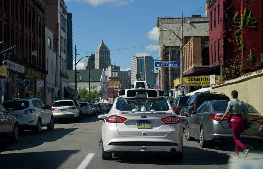 A new study finds that Uber (and likely other such services, like Lyft) actually reduce traffic congestion.Pictured: Ford Fusions modified by Uber for autonomous use map out the streets of Pittsburgh ahead of the launch of its driverless system. New rules of the road for robot cars coming out of Washington this week could lead to banning human drivers. Photo: Jeff Swensen /New York Times / NYTNS