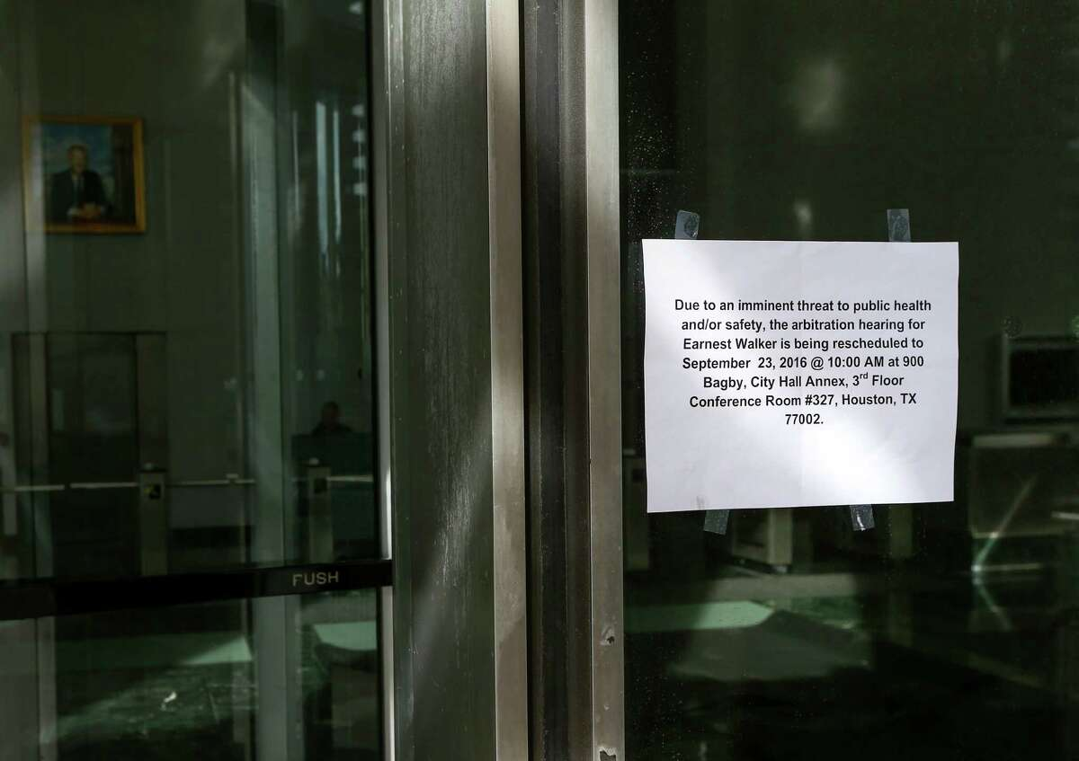 Sign shows that the Bob Lanier Public Works Building is closed, Friday, Sept. 23, 2016, in Houston.