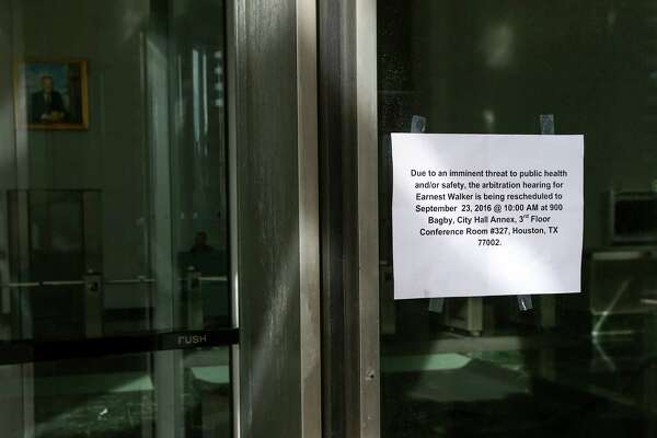 The sign shows that the Bob Lanier Public Works Building is closed, Friday, Sept. 23, 2016, in Houston.