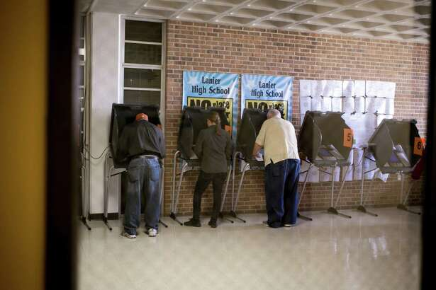 Voters check in at a polling station on Super Tuesday in Austin, Texas on March 1. A federal appeals court in July ruled Texas strict voter ID law, passed in 2011, discriminates against minorities. A study confirms that in-person voter fraud, what voter ID is designed to prevent, just doesn't happen much at all.