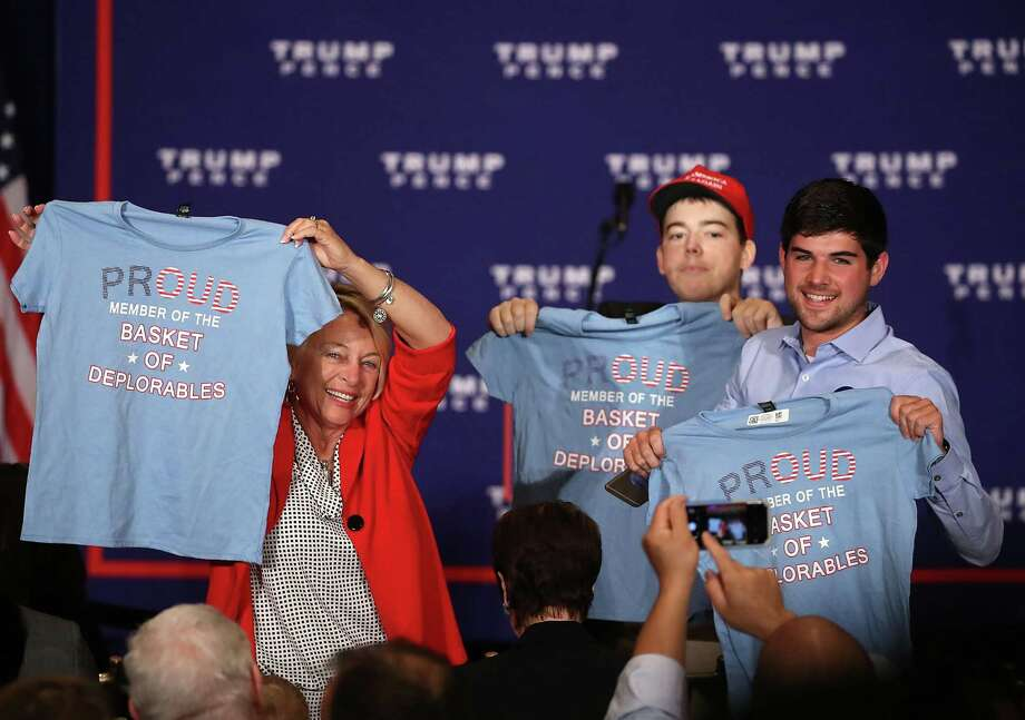 "Supporters of Republican presidential nominee Donald Trump hold up T-shirts that read ""Proud to be a basket of deplorables"" during a campaign event in Washington, D.C. The phrase refers to a comment Hillary Clinton made about Trump backers. Readers have much to say about the presidential race. Photo: Mark Wilson /Getty Images / 2016 Getty Images"
