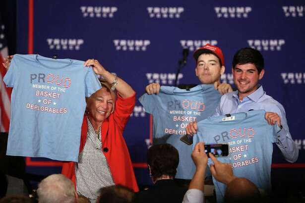 """Supporters of Republican presidential nominee Donald Trump hold up T-shirts that read """"Proud to be a basket of deplorables"""" during a campaign event in Washington, D.C. The phrase refers to a comment Hillary Clinton made about Trump backers. Readers have much to say about the presidential race."""