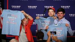 "Supporters of Republican presidential nominee Donald Trump hold up T-shirts that read ""Proud to be a basket of deplorables"" during a campaign event in Washington, D.C. The phrase refers to a comment Hillary Clinton made about Trump backers. Readers have much to say about the presidential race."