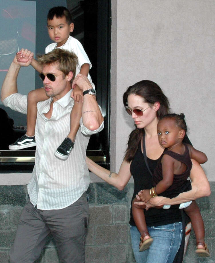 "Bad Pitt with the couple's son Maddox and Angelina Jolie with their daughter Zahara in Mumbai, India in 2014. Count how many times observers will use the word ""adopted"" when describing their breakup, as if that makes any difference to the family. Photo: Uncredited /Associated Press / AP"