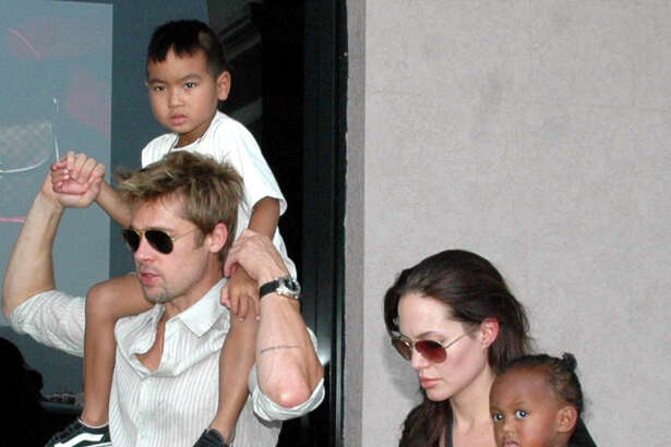 "Bad Pitt with the couple's son Maddox and Angelina Jolie with their daughter Zahara in Mumbai, India in 2014. Count how many times observers will use the word ""adopted"" when describing their breakup, as if that makes any difference to the family."
