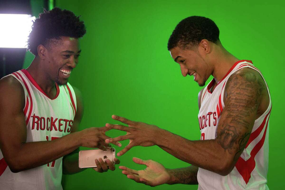 Houston Rockets guard Isaiah Taylor, left, and Rockets guard Gary Payton II, right, play a game of rockÐpaperÐscissors during the Rockets media day at the Toyota Center, Friday, Sept. 23, 2016, in Houston.