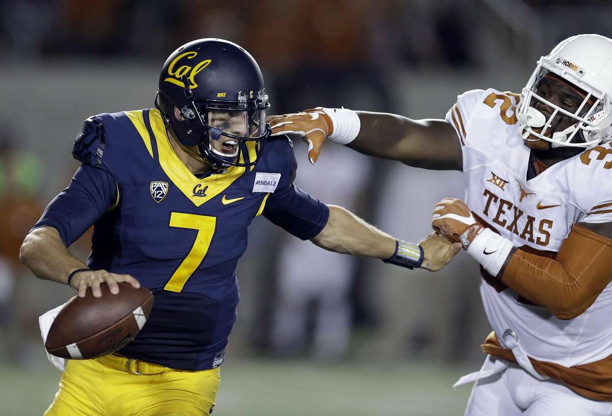 California quarterback Davis Webb (7) is pressured by Texas linebacker Malcolm Roach (32) during the second half of an NCAA college football game Saturday, Sept. 17, 2016, in Berkeley, Calif. California won, 50-43. (AP Photo/Ben Margot)