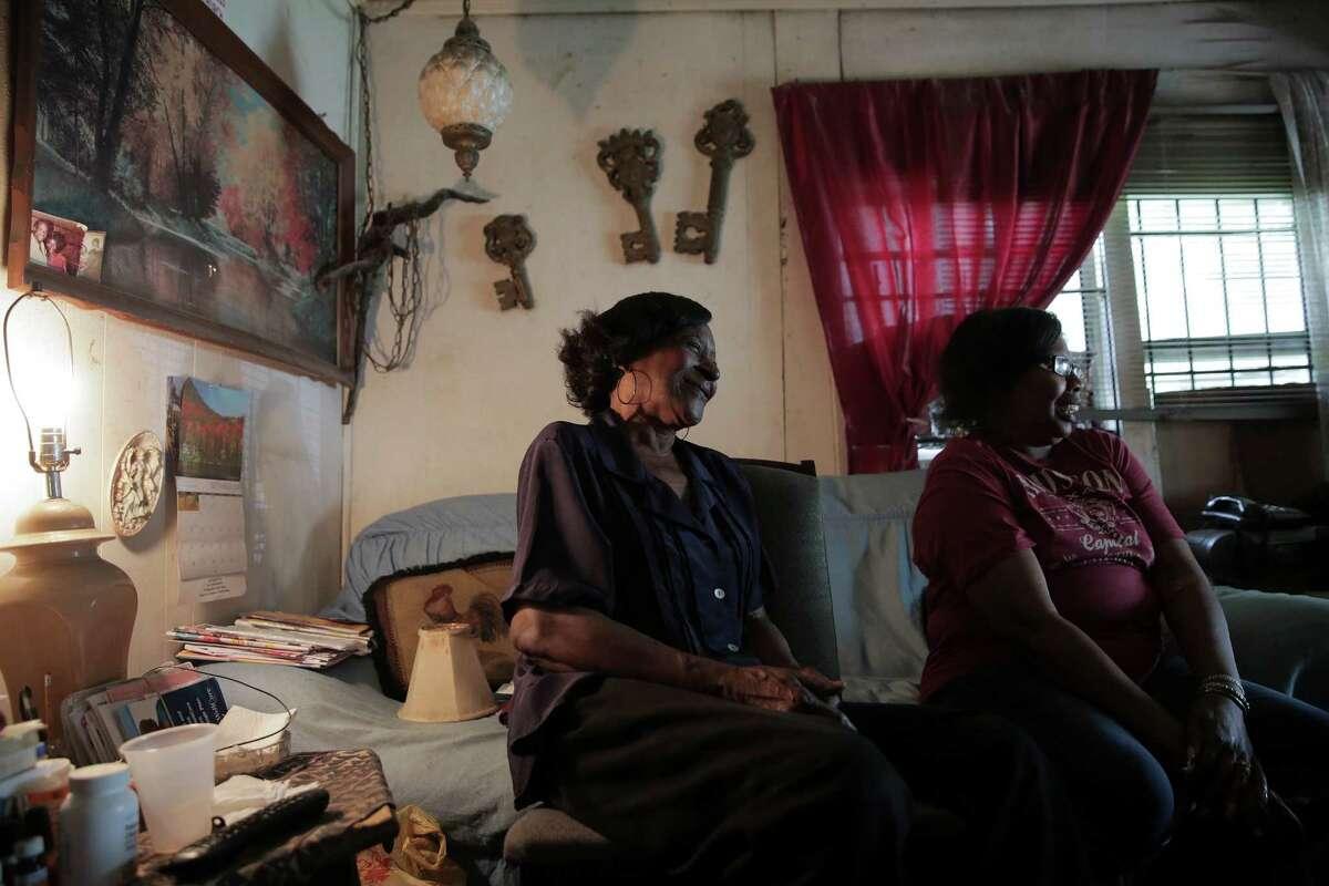 Sammy Wiley, left, and her neighbor Debra Walker, laugh in Wiley's Sunnyside neighborhood home on Thursday, Sept. 1, 2016, in Houston. ( Elizabeth Conley / Houston Chronicle )