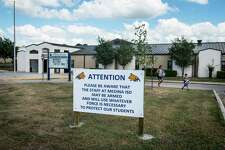 A student is picked up from Medina Elementary School where a sign warns that the public school staff could be armed and willing to use force to protect students on Friday, September 23, 2016 in Medina, Texas. Three signs are erected on the Medina ISD campuses.