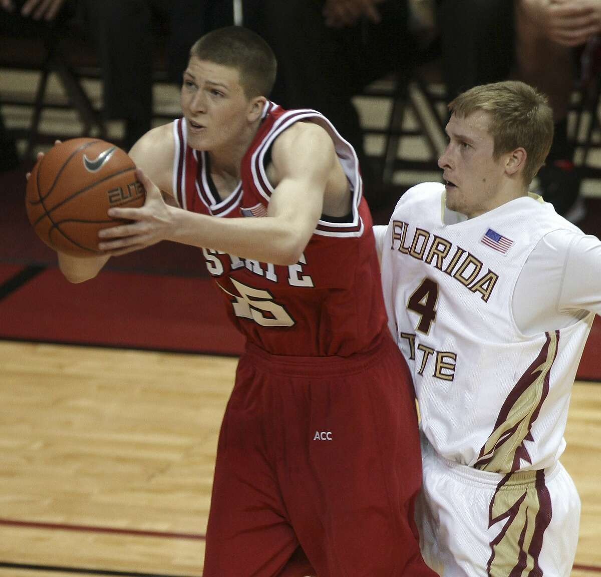 North Carolina State's Scott Wood, left, drives for two second-half points as Florida State's Deividas Dulkys defends during an NCAA college basketball game Tuesday, Jan. 12, 2010, in Tallahassee, Fla. North Carolina State won 88-81. (AP Photo/Phil Coale)