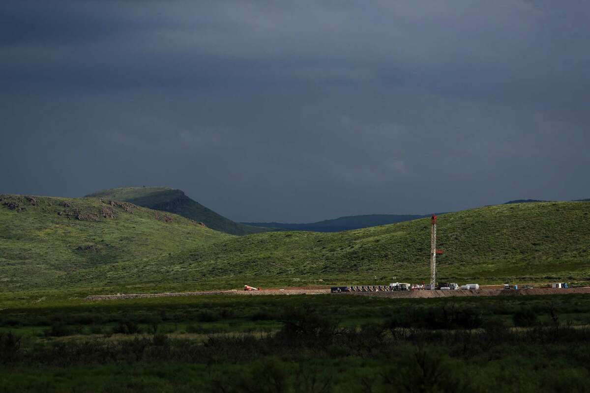 A drilling rig sits north of the Davis Mountains Friday, Sept. 16, 2016 in Balmorhea. Houston-based Apache Corporation recently announced the discovery of an estimated 15 billion barrels of oil and gas in the area and plans to drill and use hydraulic fracturing on the 350,000 acres surrounding the town. Apache has leased the mineral rights under the town and nearby state park, but has promised not to drill on or under either. While some residents worry that the drilling could affect the spring at the state park and impact tourism, others are excited for the potential economic boom the oil discovery and drilling could bring.