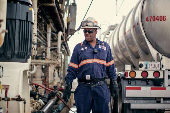 """A Kinder Morgan employee works at the terminal facility in Galena Park. The company """"is exhibiting relative strength versus its commodity counterparts,"""" says one financial planner."""