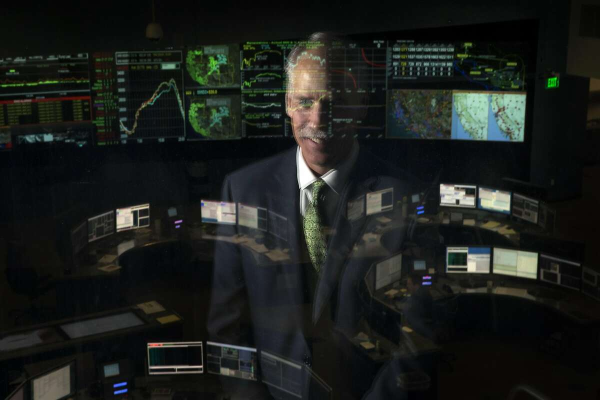 Eric Schmitt, the Vice President of Operations at California Independent System Operator, with the organization's control room behind him in Folsom, Calif., on Thursday, September 15, 2016. September 27th marks the 10th anniversary of California's landmark climate change law, AB32, and Cal ISO manages up to 30% of power created from renewable resources.