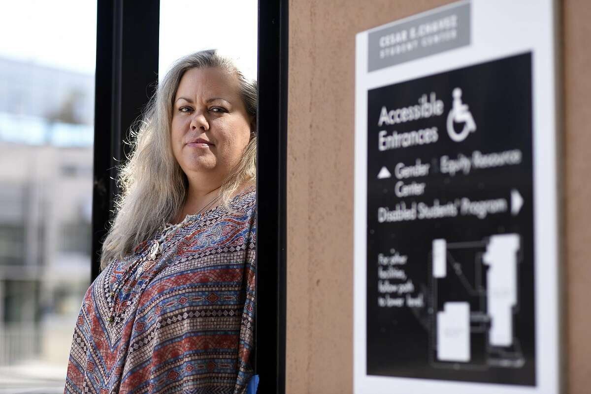 Lisa Albertson poses for a portrait near the Disabled Students Program offices on the University of California campus in Berkeley, CA Friday, September 23, 2016.