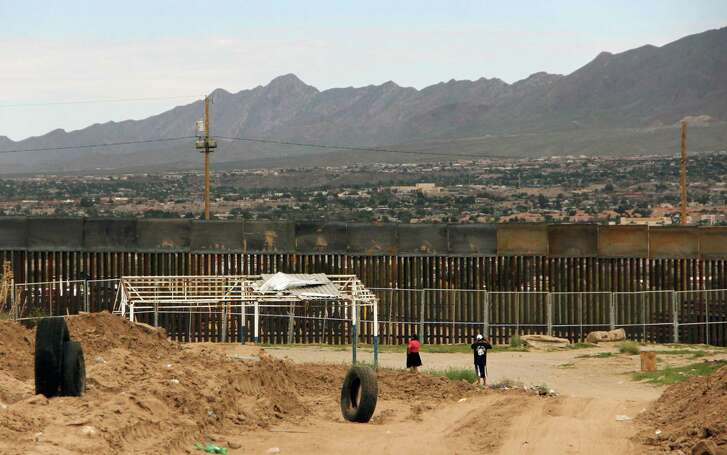 Local residents look at a higher new metal wall installed to replace fencing along the border between Ciudad Juarez and El Paso, Texas. (AFP/ Getty Images)