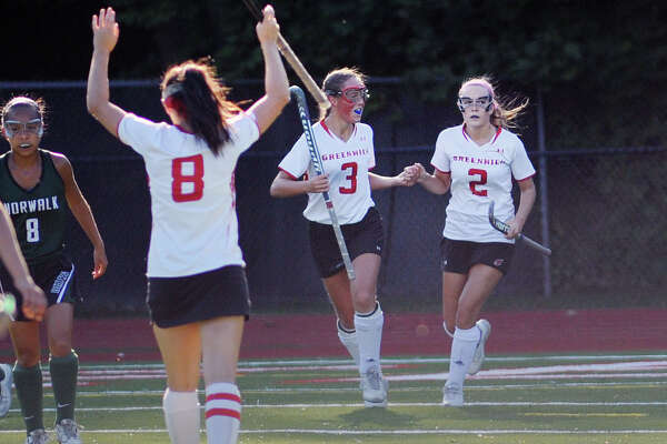 Maggie O'Gorman, No. 2, of Greenwich is congratulated by teammate Sam Chabot, center, as teammate Paige Mautner, No. 8, reacts to the first-half goal Friday. Greenwich won the match 5-4 on an overtime goal by O'Gorman.