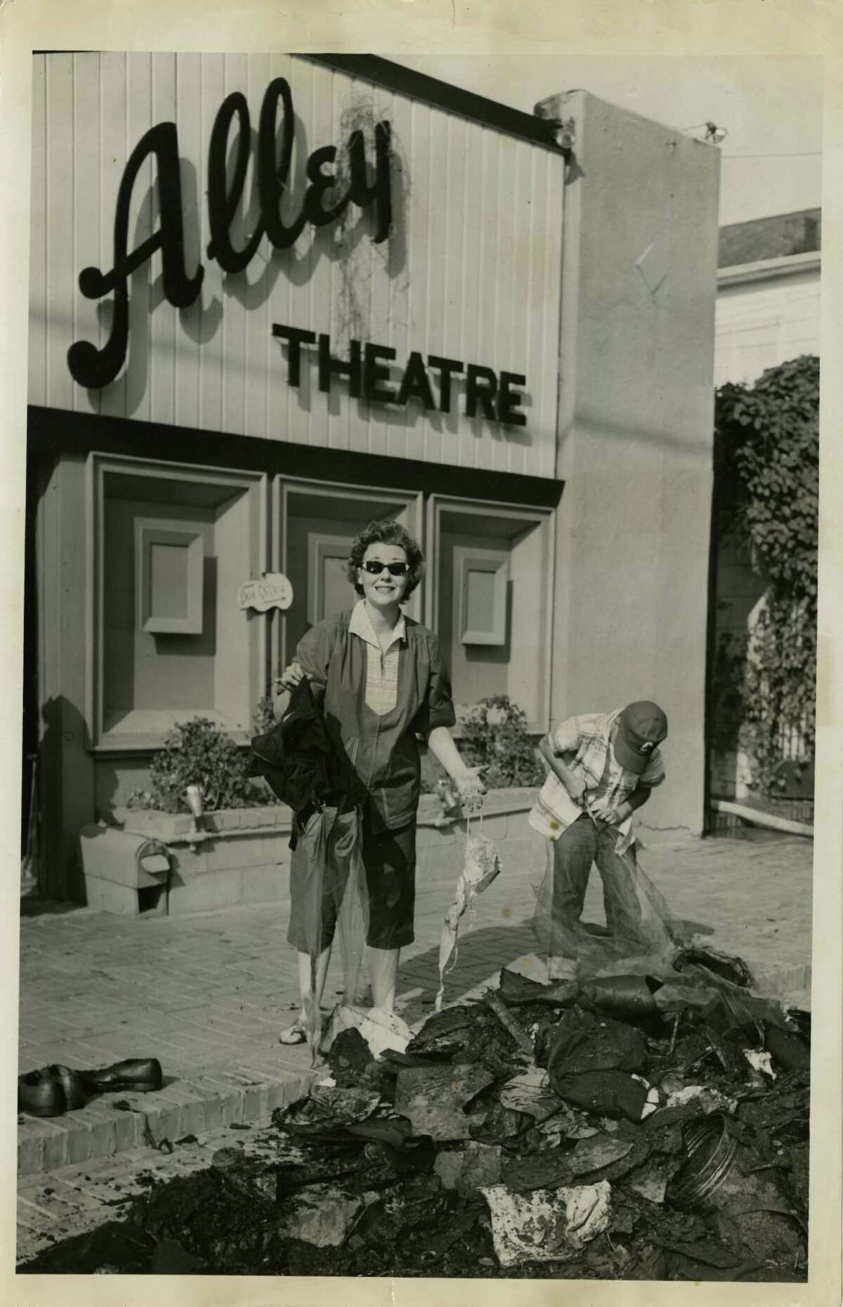 05/19/1956 - Actress Mary Jane Maricle sorts the charred remnants of the Alley Theatre's wardrobe for its production